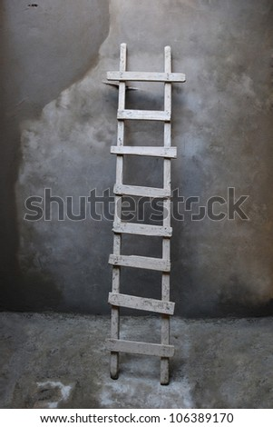 a ladder on the wall - stock photo