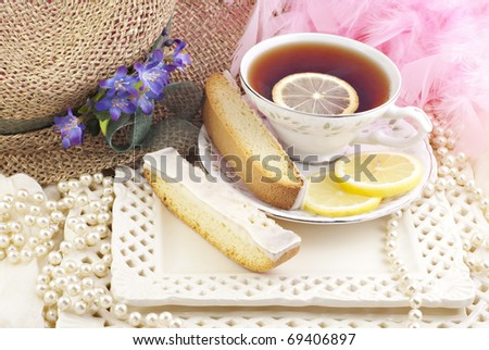 A ladies tea party with lemon biscotti and tea with lemon - stock photo
