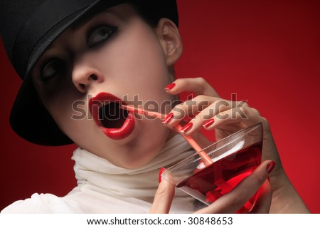 a lady with hat is drinking cocktail - stock photo