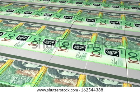 A laid out collection of bundled one hundred australian dollar bill notes - stock photo