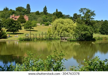A lake at an English country estate in August,
