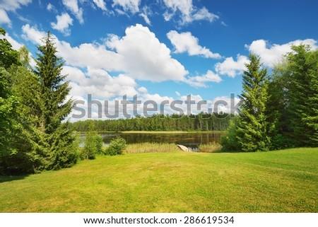 A lake in Estonia in beautiful summer day - stock photo