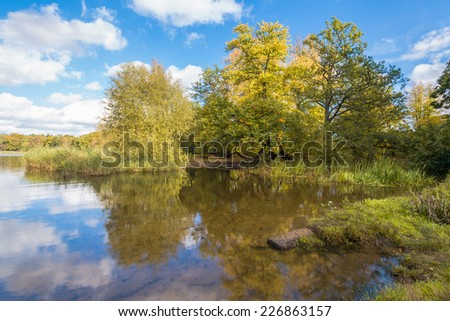 A lake in the park with colorful autumn tree reflections