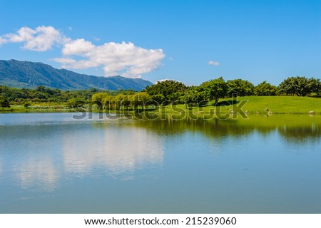 a lake under the clear sky - stock photo