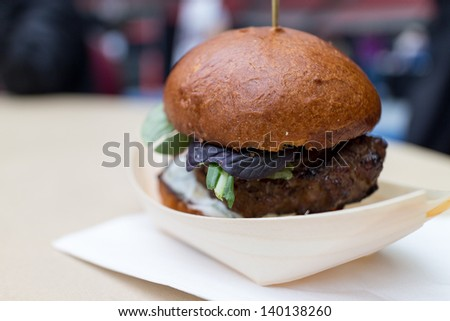 a lamb slider with pickles - stock photo