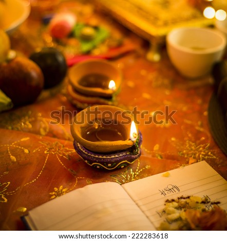 A lamp in a puja set up  for an Indian festival - Diwali  - stock photo