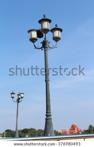 a lamp post on a background of blue sky