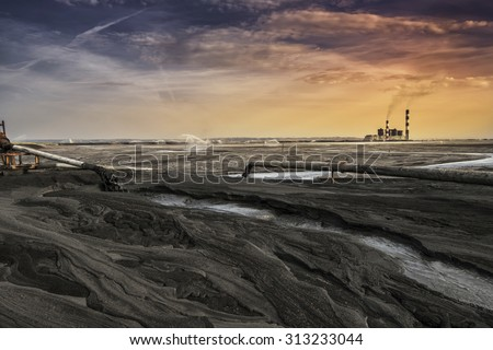 A land of ash. Hundreds of square miles covered with lifeless ash. Ash waste is produced by burned coal in a power plant.  - stock photo