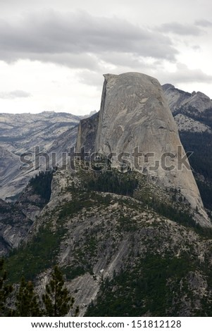 A landscape depicting the famous granite formations of Yosemite National Park, California, USA including the Half Dome.