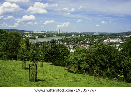 A landscape image from high on a hill with the German city Bonn faraway in the distance