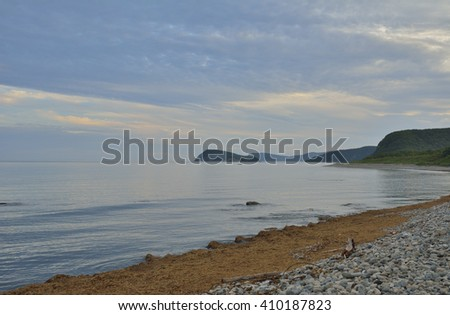 A landscape on sea, evening, sunset.