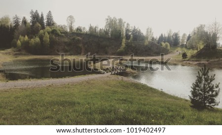 a landscape shot of a lake in summer
