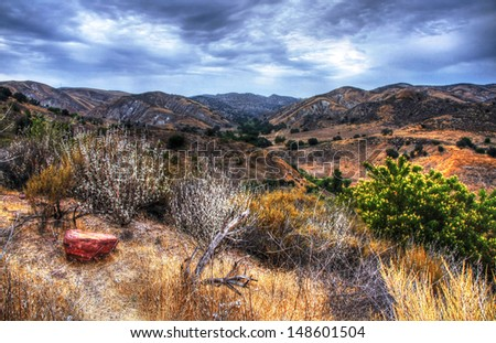A landscape shot of rolling hills and dry brush on a trail in the Santa Monica Mountains. - stock photo