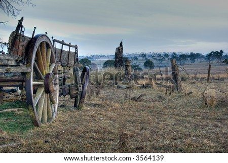 a landscape view of paddock and old forgotten cart