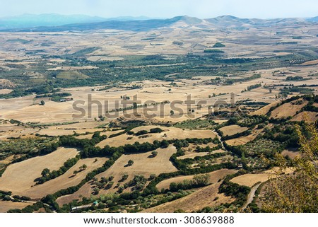 A landscape with fields, hills and mountains from above in Gesturi, Sardinia. Closed to Giara di Gesturi.  - stock photo