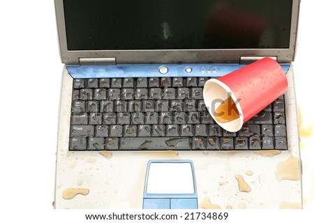 a laptop computer with spilled liquid on the keyboard isolated on white - stock photo