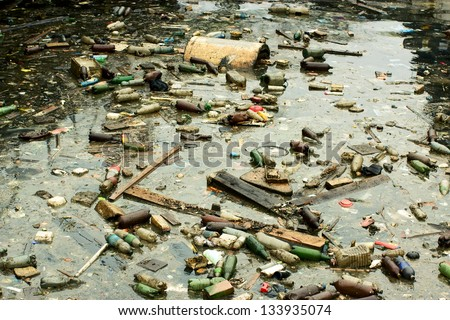 A large amount of trash polluting our waters - stock photo