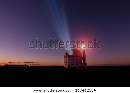 a large astronomical telescope open with a beam of light projecting to the heavens - stock photo