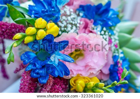 A large bouquet of flowers of different colors
