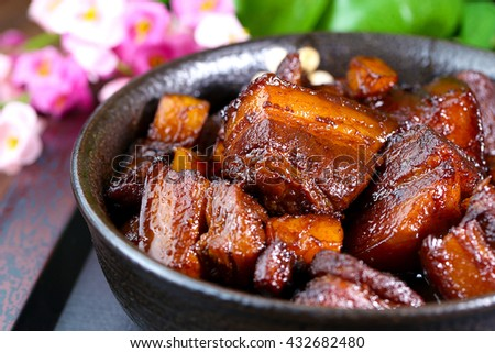 A large bowl of Braised pork in brown sauce