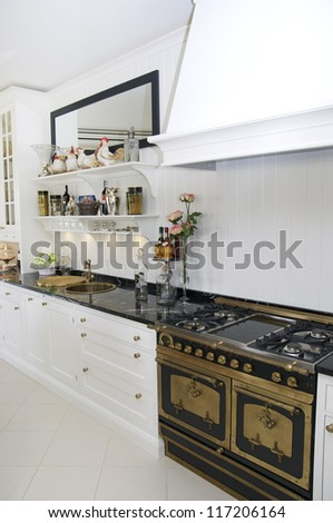 a large bright kitchen with gas stove kitchen - stock photo