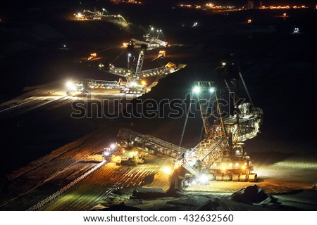 A large bucket wheel excavator in a lignite (brown-coal) mine at night, Germany - stock photo