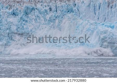 A large calving of hubbard glacier.  - stock photo