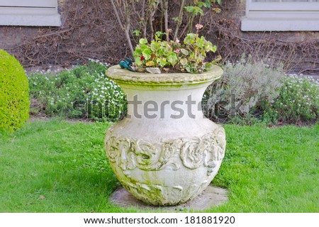 A large clay pot in a home garden - stock photo
