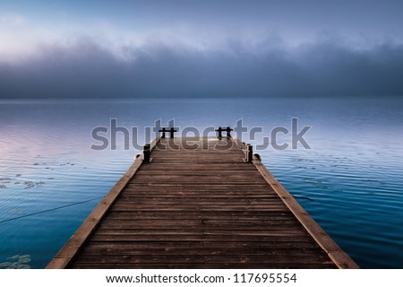 A large cloud of misty an empty dock in morning calm wind - stock photo