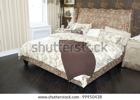 a large comfortable bedroom in the style of the nineteenth century - stock photo