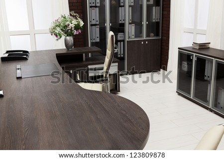 a large desk in a modern office - stock photo