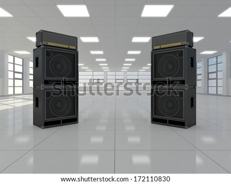 A large empty room in which there are guitar amps - stock photo