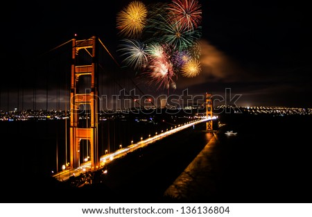 A large firework show in the background of Golden Gate Bridge in San Francisco - stock photo