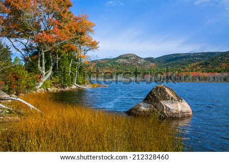 A Large Glacial Erratic Boulder Sits In Seal Cove Pond On A Beautiful Autumn Afternoon, Mount Desert Island, Acadia National Park, Maine, USA - stock photo