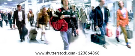 A large group of arriving passengers. Panorama. Motion blur. - stock photo