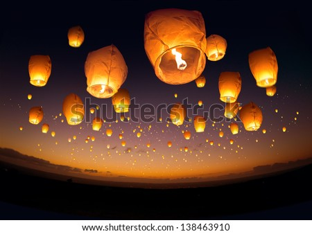 A large group of chinese flying lanterns. - stock photo