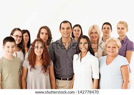 A large group of different people posing together. - stock photo