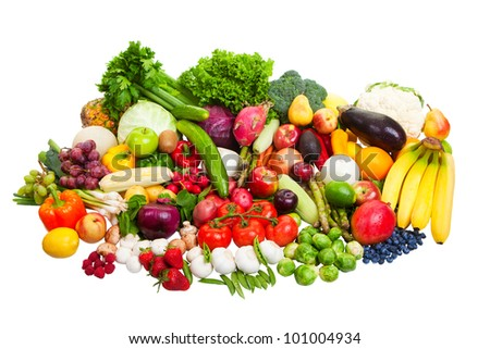 A large group of fruit and vegetables isolated on a white background. - stock photo