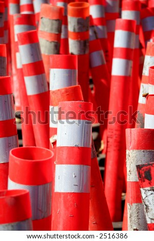 A large group of orange caution cones - stock photo