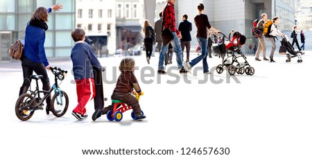 A large group of people in the city. - stock photo