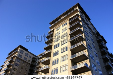 A large high rise commercial apartment, condominium building. - stock photo