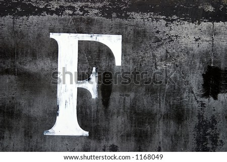 A large letter F painted on the side of an old train car - stock photo