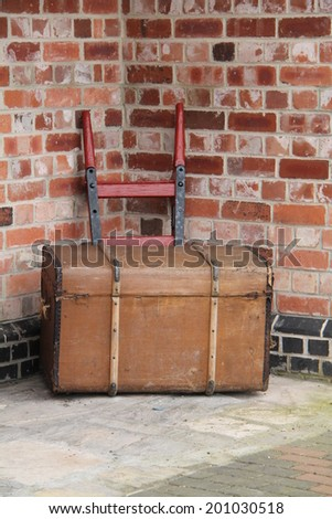 A Large Luggage Trunk on a Traditional Railway Trolley. - stock photo