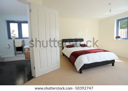 A large master bedroom in a newly built property