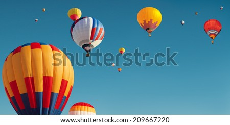 a large number of balloons flying in the sky
