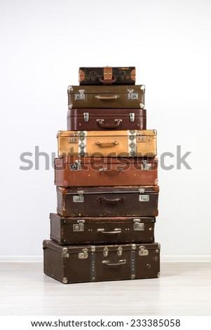 A large number of old suitcases. Old suitcases stacked in the interior.