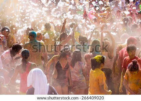 A large number of people in the colorful outdoor festival - stock photo
