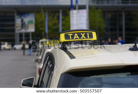 A large number of taxis waiting for passengers at the airport