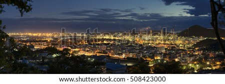 A large oil-refinery plant panorama view .