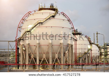 A large oil-refinery plant with Liquefied Natural Gas (LNG) storage tanks. - stock photo